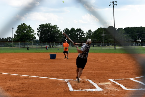 Staff Sgt. Robert Mullen, 19th Maintenance Group airspace ground equipment specialist, hits a home run during the 2017 Softball All-Star Day Home Run Derby Aug. 3, 2017, at Little Rock Air Force Base, Ark. The Home Run Derby was a free-for-all batting match for players to claim the derby trophy. (U.S. Air Force photo by Senior Airman Mercedes Taylor)