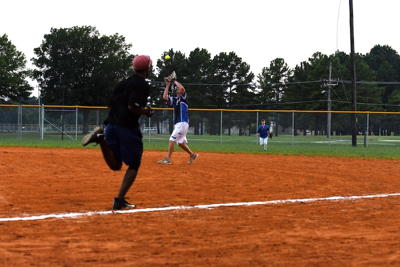Tech Sgt. Bolin Belles, National League team member, runs for first base during the 2017 Softball All-Star Day game Aug. 3, 2017, at Little Rock Air Force Base, Ark. After winning 14-9, the National League took home the trophy. (U.S. Air Force photo by Senior Airman Mercedes Taylor)