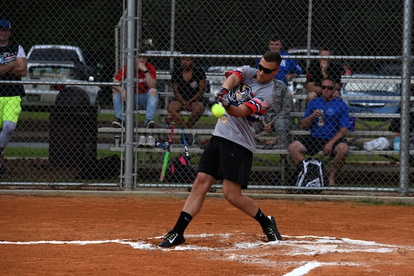 Senior Airman Aaron Elmore, 19th Operations Support Squadron air traffic controller, hits a softball during the 2017 Softball All-Star Day Home Run Derby Aug. 3, 2017, at Little Rock Air Force Base, Ark. Each competitor had 10 minutes and two rounds to hit as many home runs as possible. (U.S. Air Force photo by Senior Airman Mercedes Taylor)