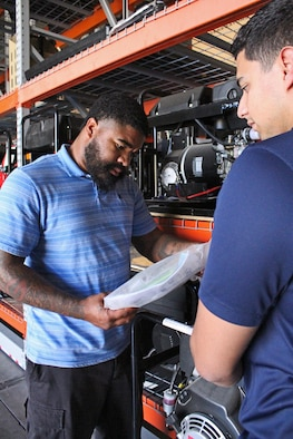 From left, Desmond Jones and David Rodriguez, members of the Air Force Security Forces Center Desert Defender Ground Combat Readiness Training Center's Logistics Detail, inventory obsolete generators.