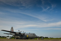 A modified U.S. Air Force C-130 Hercules assigned to the 757th Airlift Squadron from Youngstown, Ohio, sits on the North ramp at Joint Base Langley-Eustis, Va., Aug. 1, 2017. The aerial spray technicians loaded the C-130 with insecticide that was sprayed over Langley Air Force Base and Craney Island, Va., to prevent vector borne diseases spread by mosquitos. (U.S. Air Force photo/Staff Sgt. Carlin Leslie)
