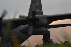 U.S. Air Force Staff Sgt. Bradley Hutchison, 757th Airlift Squadron aerial spray team technician, assists in engine start-up during a mosquito spraying mission at Joint Base Langley-Eustis, Va., Aug. 1, 2017. With support from the 757th AS, Langley Air Force Base senior leaders are ensuring disease transmitting species are not given the chance to impact Airmen's ability to support the warfighting mission. (U.S. Air Force photo/Staff Sgt. Carlin Leslie)