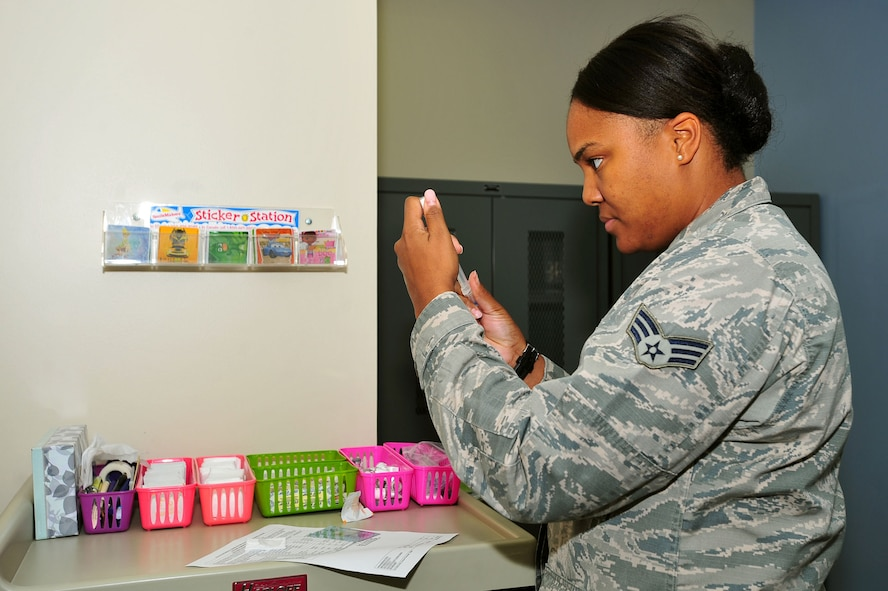 U.S. Air Force Senior Airman Tamika Bradley, 20th Medical Operations Squadron allergy and immunizations technician, prepares a pneumococcal vaccine for a patient at Shaw Air Force Base, S.C., Aug. 8, 2017. The vaccine is effective against 23 types of pneumococcal bacteria, reducing the likelihood of infections such as pneumonia. (U.S. Air Force photo by Airman 1st Class Kathryn R.C. Reaves)