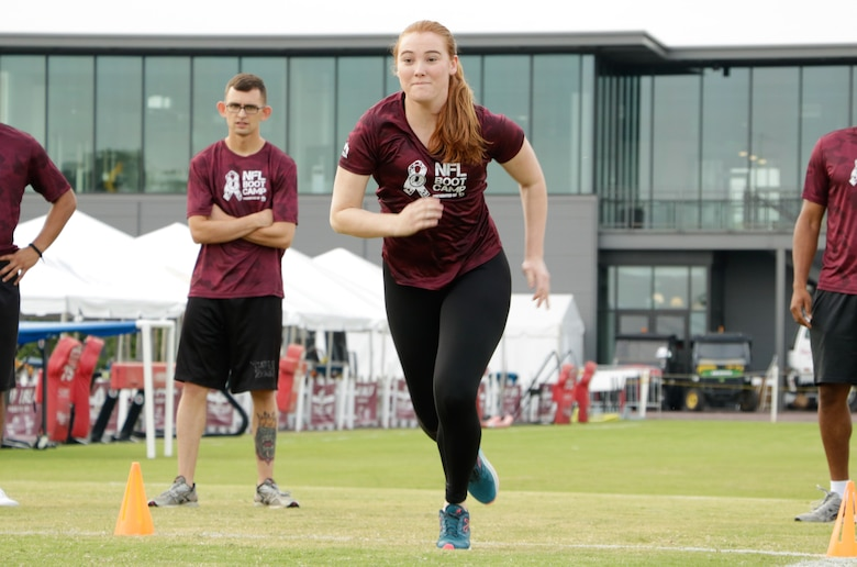 U.S. Air Force Airman 1st Class Alexandra Nason, 363rd Intelligence, Surveillance and Reconnaissance Group, participates in the 40 yard dash during the Salute to Service military appreciation event at the Washington Redskins' Bon Secours Training Camp in Richmond, Virginia, Aug. 2, 2017.