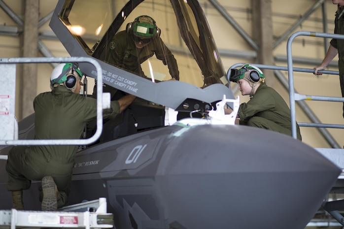 U.S. Marines with Marine Fighter Attack Squadron (VMFA) 121's seat shop, work on removing a canopy from an F-35B Lightning II aircraft at Marine Corps Air Station Iwakuni, Japan, Aug. 4, 2017. The squadron's seat shop Marines are responsible for egress systems and environmental controls and oxygen systems within the F-35B Lightning II. Ensuring proper operating systems within their area of operation keeps aircraft in the air and has the potential of saving pilots' lives.
