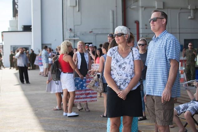 Joy and Paul Woodman wait to greet their son, Lance Cpl. Keith Woodman, an aircraft electrical technician assigned to Marine Aerial Refueler Transport Squadron 252, at Marine Corps Air Station Cherry Point, N.C., Aug. 3, 2017. VMGR-252 returned home from a six month deployment in support of the Special Purpose Marine Air Ground Task Force in Africa. VMGR-252 is assigned to Marine Aircraft Group 14, 2nd Marine Aircraft Wing. (U.S. Marine Corps Photo by Lance Cpl. Courtney T. Miner)