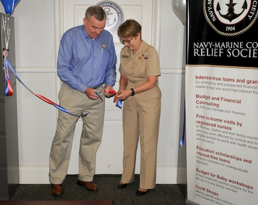 Retired Marine Corps Brig. Gen. Peter Collins (left), Navy-Marine Corps Relief Society (NMCRS) chief operations officer, and Rear Adm. Rebecca McCormick-Boyle, commander, Navy Medicine Education, Training and Logistics Command, and senior Navy officer in San Antonio, cut a ceremonial ribbon at the NMCRS San Antonio branch on board Joint Base San Antonio - Fort Sam Houston. NMCRS opened up a small, limited-functioning office in San Antonio in January 2015 but has grown with the Navy population in the area and just celebrated the opening of a full-service branch.