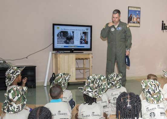 Col. Corey Simmons, 436th Airlift Wing vice commander, briefs a chalk of children during Kids Understanding Deployment Operations Aug. 3, 2017, at the Youth Center on Dover Air Force Base, Del. The briefing was done at the beginning of each chalk and was not only given by the vice wing commander but also by intel, public health and a few other organizations. (U.S. Air Force photo by Staff Sgt. Jared Duhon)