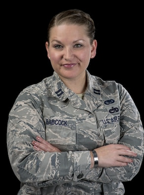 Capt. Leanne Babcock, 349th Logistics Readiness Squadron, operations officer, displays the tokens that she always keeps near, July 27, 2017 Travis Air Force Base, Calif. Men and women serving their country in all branches of the military have traditionally kept meaningful mementos or talismans close to them for good luck, as reminders, to bring comfort or other deeply felt personal reasons. (U.S. Air Force photo/ Heide Couch)