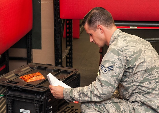 Senior Airman Timothy Brown, a B-52 Stratofortress crew-chief assigned to the 707th Maintenance Squadron, inventories a tool box on Barksdale Air Force Base, La. Aug. 5, 2017.