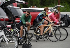 Arctic Bicycle Club athletes perform pre-race exercises in preparation for the 10-mile time-trial race at the Moose Run Golf Course at Joint Base Elmendorf-Richardson, Alaska, Aug. 3, 2017. For more than 15 years, the club has hosted road race events at JBER.