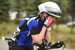 Joanne Allen wipes her face before the Moose Run time-trial race at Moose Run Golf Course at Joint Base Elmendorf-Richardson, Alaska, Aug. 3, 2017. For more than 15 years, the club has hosted road race events at JBER.
