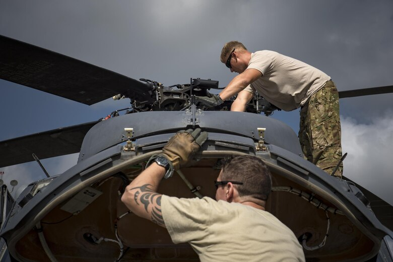 Master Sgt. Joshua Emerick, front, and Master Sgt. Zachary Ferguson, 41st Rescue Squadron, special missions aviators, inspect an HH-60G Pave Hawk prior to a sortie, Aug. 7, 2017, at Moody Air Force Base, Ga.