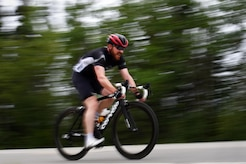 A cyclist streaks down the race path during the Moose Run time-trial race at Joint Base Elmendorf-Richardson, Alaska, Aug. 3, 2017. For more than 15 years, the club has hosted road race events at JBER.