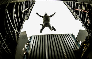 A member of the Colombian Commando Forces participates in a personnel drop from a Casa-295 flown by the Colombian Air Force at Exercise Mobility Guardian Aug. 06, 2017.  More than 3,000 Airmen, Soldiers, Sailors, Marines and international partners converged on the state of Washington in support of Mobility Guardian. The exercise is intended to test the abilities of the Mobility Air Forces to execute rapid global mobility missions in dynamic, contested environments. Mobility Guardian is Air Mobility Command's premier exercise, providing an opportunity for the Mobility Air Forces to train with joint and international partners in airlift, air refueling, aeromedical evacuation and mobility support. The exercise is designed to sharpen Airmen's skills in support of combatant commander requirements. (U.S. Air Force Photo by Tech. Sgt. Gregory Brook)