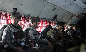 A multinational group of service members from the French Air Force, Colombian Air Force, Pakistan Air Force, Belgian Air Force, Brazilian Air Force, and Argentine Air Force, conduct a personnel drop from a Casa-295 flown by the Colombian Air Force to earn jump wings with the Colombian Commando Forces at Exercise Mobility Guardian Aug. 06, 2017.  More than 3,000 Airmen, Soldiers, Sailors, Marines and international partners converged on the state of Washington in support of Mobility Guardian. The exercise is intended to test the abilities of the Mobility Air Forces to execute rapid global mobility missions in dynamic, contested environments. Mobility Guardian is Air Mobility Command's premier exercise, providing an opportunity for the Mobility Air Forces to train with joint and international partners in airlift, air refueling, aeromedical evacuation and mobility support. The exercise is designed to sharpen Airmen's skills in support of combatant commander requirements. (U.S. Air Force Photo by Tech. Sgt. Gregory Brook)