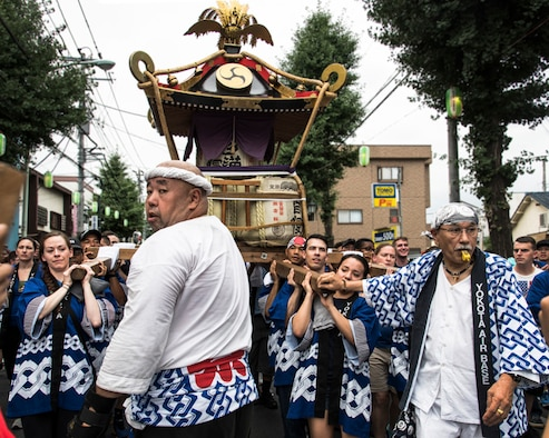 Members from Yokota Air Base carry a mikoshi, or portable shrine, during the 67th Annual Fussa Tanabata Festival in Fussa City, Japan, Aug. 4, 2017.The festival gave Yokota members the opportunity to meet and build friendships with the local community while experiencing Japanese culture. (U.S. Air Force photo by Machiko Arita)