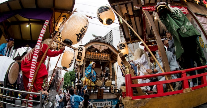 Several festival floats face each other and compete in a hayashi performance, or a traditional Japanese orchestra, and dance. The festival included the carrying of Mikoshi, traditional Japanese dancing parade, live stages, food venders and more. (U.S. Air Force photo by Machiko Arita)