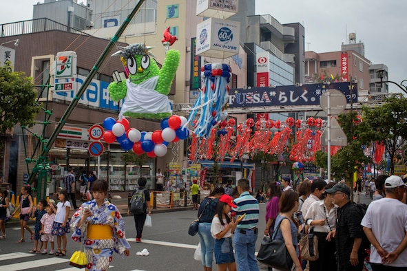 Tanabata decorations hang over a street during the 67th Annual Tanabata Festival at Fussa City, Japan, Aug. 4, 2017. The festival celebrates the yearly meeting of a mythical prince and princess among the Milky Way. This year's festival theme is Fussa City uniquely integrated with an international and American culture. (U.S. Air Force photo by Yasuo Osakabe)
