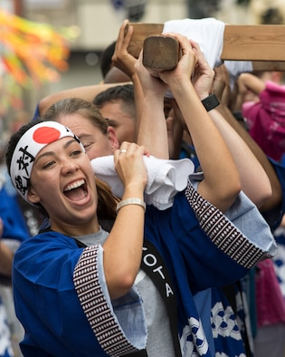 Airmen from Yokota Air Base carry the wing mikoshi during the 67th Annual Fussa Tanabata Festival at Fussa City, Japan, Aug. 4, 2017. The festival gave Yokota members an opportunity to build friendships with the local community while experiencing Japanese culture. (U.S. Air Force photo by Yasuo Osakabe)