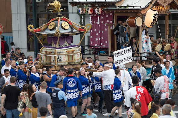 Members from Yokota Air Base carry the wing mikoshi, or a portable shrine, during the 67th Annual Fussa Tanabata Featival at Fussa City, Japan, Aug. 4, 2017. More than 80 volunteers from Yokota carried the shrine during this year's festival; Yokota Airmen have attended the festival since 1958 and have actively participated in carrying a mikoshi since 1975. (U.S. Air Force photo by Yasuo Osakabe)