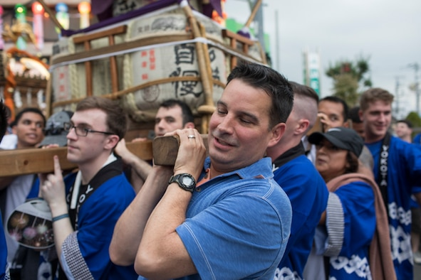 Col. Sergio Vega Jr., 374th Airlift Wing vice commander, carries the wing mikoshi during the 67th Annual Fussa Tanabata Festival at Fussa City, Japan, Aug. 4, 2017. The festival gave Yokota members an opportunity to build friendships with the local community while experiencing Japanese culture. (U.S. Air Force photo by Yasuo Osakabe)