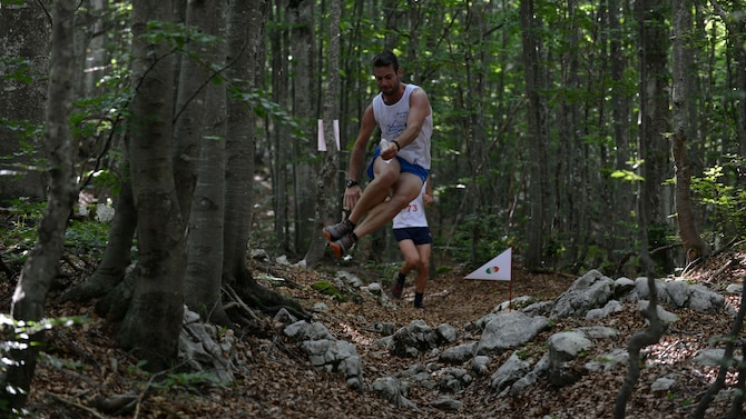 An Italian competitor jumps over obstacles during the 51st annual Madonna delle Nevi Alpini Run, August 6, 2017, in Piancavallo, Italy. Approximately 22 American and 49 Italian, two-person teams competed in the 7 km event. (U.S. Air Force photo by Senior Airman Cary Smith)