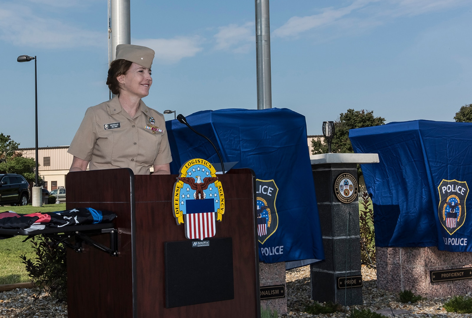 DLA Land and Maritime Commander Navy Rear Adm. Michelle Skubic speaks at the dedication of the Police and Fire Memorial at Defense Supply Center Columbus.