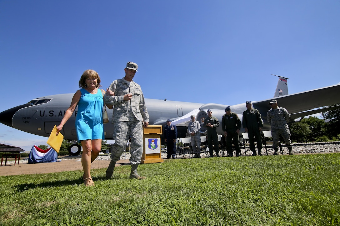 Danielle Giblin, left, is escorted by Brig. Gen. Kevin Keehn, Commander, New Jersey Air National Guard, during a KC-135 Stratotanker static display naming event in memory of Lt. Col. Paul Giblin on Joint Base McGuire-Dix-Lakehurst, N.J., Aug. 5, 2017.