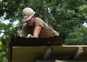 A U.S. Navy Sailor builds a roof for Escuela Rural Mixta Luz Infantil, a local elementary school, during a Southern Partnership Station 17 community relations project