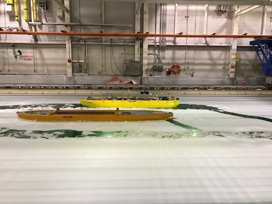 A model icebreaker demonstrates its maneuverability during a test at the National Research Council of Canada's facility in St. Johns, Newfoundland, on July 26, 2017. The test showcased the progress made on the testing and evaluation of design models for the U.S. Coast Guard's icebreaker acquisition program, which is being supported by an international, multiagency team including engineers from Naval Surface Warfare Center, Carderock Division. (U.S. Navy photo by Steven Ouimette/Released)