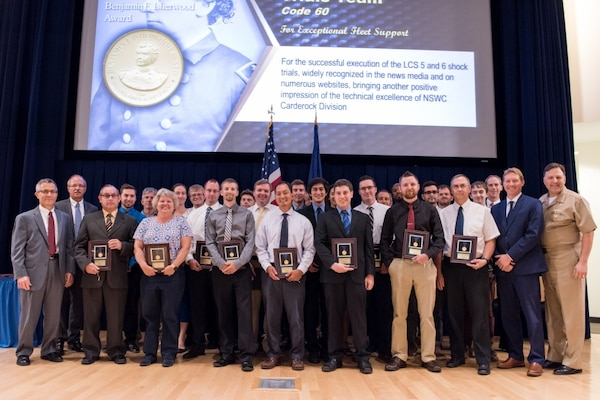 The Littoral Combat Ship (LCS) Full-Ship Shock Trials Team receives the Rear Adm. Benjamin F. Isherwood Award for exceptional fleet support at the Naval Surface Warfare Center, Carderock Division Honor Awards ceremony Aug. 1, 2017, in West Bethesda, Md. About 40 employees from Carderock's Survivability, Structures, Materials and Environmental Department were part of the team, which was led by Henry Joseph (Joe) Venne, branch head for the Underwater Explosion (UNDEX) and Trials Program Office. (U.S. Navy photo by Jake Cirksena/Released)