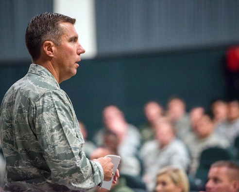 U.S. Air Force Col. John Klein, 60th Air Mobility Wing commander, gives a briefing during his commander's call at Travis Air Force Base, Calif., August 8, 2017. Klein discussed a variety of topics to include safety, projecting American power and how every Airmen fits into the mission. (U.S. Air Force photo by Louis Briscese)