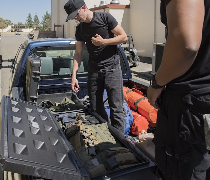 U.S. Air Force Survival, Evasion, Resistance and Escape instructors and augmentees prepare for a training session for aircrew members that will last well into the evening in a remote area near Travis Air Force Base, Calif., Jul. 17, 2017.