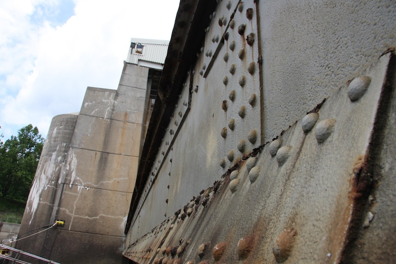 The Montgomery Dam was built in 1934. Its gates were originally designed to meet the 1934 design standard for dead, hydraulic and vertical ice load; however, they were not designed for barge impact and horizontal ice load.