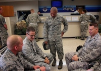 Chief Master Sgt. George Vaughn, the 932nd Airlift Wing Medical Group Superintendent, shares his best wishes and a fond farewell to several 932nd MDG Airmen during the last few minutes before they take off on a C-40 flight to the special Patriot Warrior event August 9, 2017 at Scott Air Force Base, Illinois. Both the 932nd Aeromedical Staging Squadron and Medical Squadron are preparing for a ride out of town to Patriot Warrior, which is an integrated operational and medical joint field training exercise designed to evaluate the ability to deploy medical capabilities to support joint theater operations. (U.S. Air Force photo by Lt. Col. Stan Paregien)