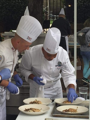 Marine Corps Staff Sgt. Kevin M. Johnson, left, the food service chief for the 26th Marine Expeditionary Unit, prepares entrée plates with his culinary team at the All Armed Forces Culinary Competition in October 2015. Johnson earned new accolades as the Marine Corps fiscal year 2017 active duty staff noncommissioned officer Food Service Specialist of the Year award winner in the Maj. Gen. William P. T. Hill Memorial Awards Program for Food Service Excellence. Courtesy photo