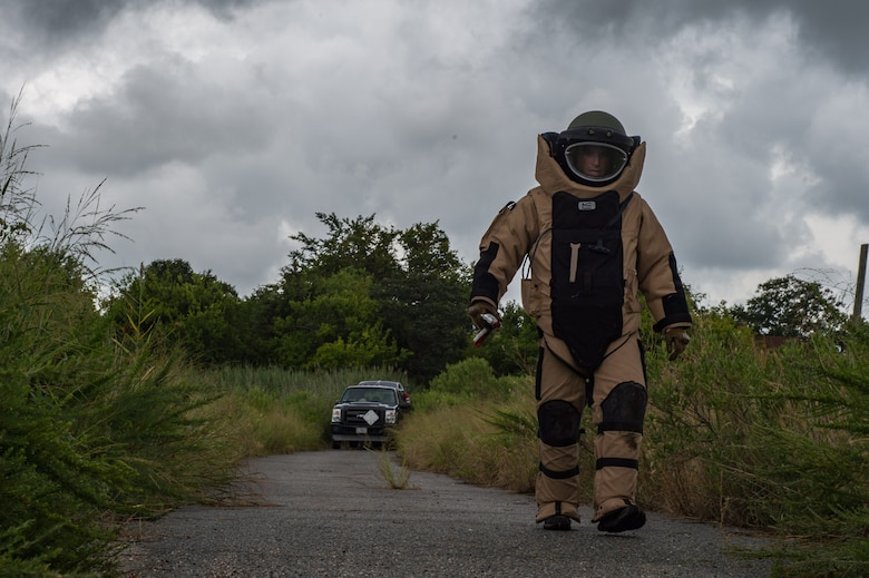 A robot is controlled by a U.S. Air Force Airman assigned to the 11th Civil Engineer Squadron Explosive Ordinance Disposal flight, as it approaches a training improvised explosive device during Operation Llama Fury three point zero at Joint Base Langley-Eustis, Virginia., August 8, 2017.