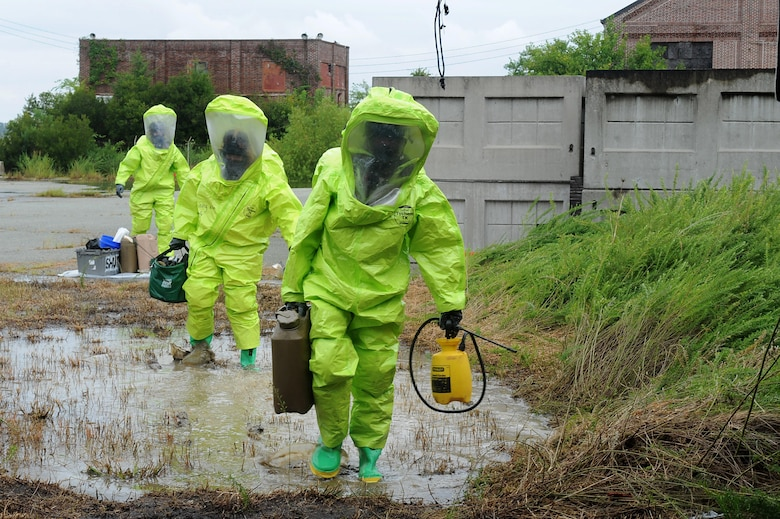 U.S. Air Force Airmen assigned to the 633rd Civil Engineer Squadron Explosives Ordinance Disposal flight, participate in a simulated chemical unexploded ordnance evaluation training during Operation Llama Fury three point zero at Joint Base Langley-Eustis, Virginia., August 8, 2017.