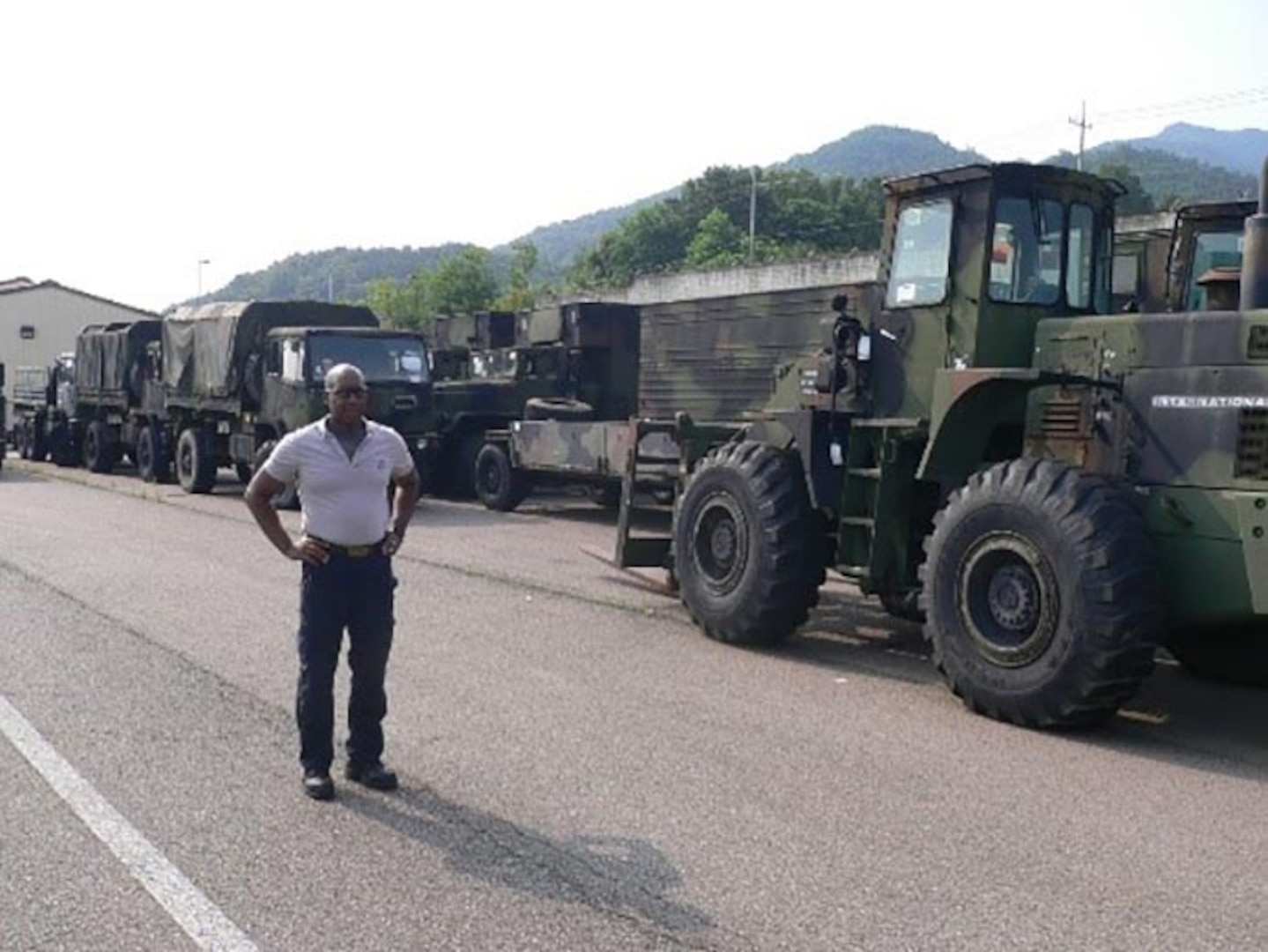 Area Manager Terry Harrington surveys some of the vehicles being turned in through DLA Disposition Services at Gimcheon as part of the Class II and Class VII Excess Reduction.