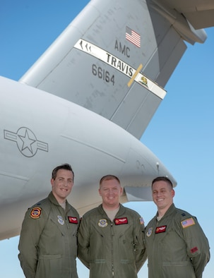 From left, U.S. Air Force Capt. Justen Fazekas, Staff Sgt. John Ledford and Capt. Michael Schwartz from the 21st Airlift Squadron, Travis Air Force Base, Calif., pose for a photo July 27, 2017. The aircrew flew five critically injured U.S. Army Soldiers in the C-17 Globemaster III pictured during an aeromedical evacuation mission from Bagram Airfield, Afghanistan to Ramstein Air Base, Germany on June 18, 2017. The Soldiers were injured during an insider attack at Camp Shaheen, in the northern city of Mazar-i-Sharif. Also part of the crew but not pictured are Capt. Linden Ballen, Tech. Sgt. Daryl Metheny, and Senior Airman Cole Pincin. (U.S. Air Force photo by Louis Briscese)