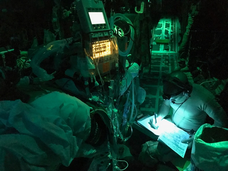 Members of the 455th Expeditionary Aeromedical Evacuation Squadron provide care for U.S. Army Soldiers who were wounded in a rocket propelled grenade attack in a C-130J Super Hercules during a flight to Bagram Airfield, Afghanistan June 17, 2017. The Soldiers underwent 12 hours of trauma care at Craig Joint Theater Hospital at Bagram before they were flown to Germany by a C-17 Globemaster III from Travis Air Force Base, Calif. (Courtesy Photo)