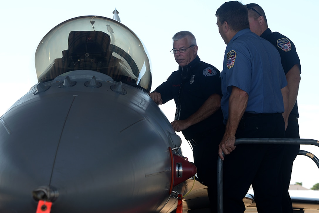William Ferguson, a captain with the 177th Fighter Wing's Fire Department, provides F-16 familiarization training to the Atlantic City Fire Department and the New Jersey State Police Technical Emergency and Mission Specialist Unit at the 177th Fighter Wing Fire Station in Egg Harbor Township, New Jersey, Aug. 9, 2017. This training was designed to help local first-responders identify F-16 danger zones and hazards in the event of an F-16 crash. (U.S. Air National Guard photo by Airman 1st Class Cristina J. Allen/Released)