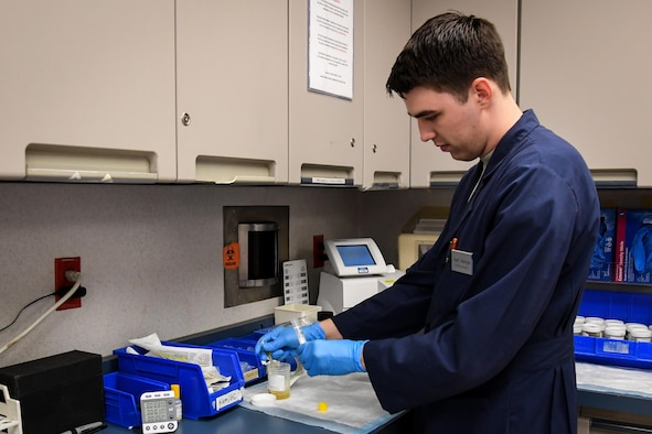 Senior Airman Josef, 2nd Medical Group laboratory technician, draws a sample for testing at Barksdale Air Force Base, La., Aug. 2, 2017. Technicians process a variety of tests daily, demanding focus and accuracy in handling results. (Photo/ Samantha Maiette)
