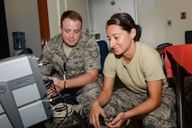 U.S. Air Force Staff Sgt. Michael Ostrom and Staff Sgt. Katia Cordonaldana, both aircrew flight equipment technicians assigned to the 140th Wing, Colorado Air National Guard, perform routine maintenance checks on a radio transponder set at Kadena Air Base, Japan,  June 6, 2017. Both Airmen are supporting the routine Theatre Security Package responsible for helping maintain stability and security in the Pacific region. (U.S. Air Force Colorado National Guard photo by Staff. Sgt. Bobbie Reynolds)