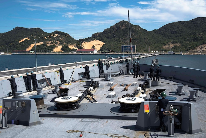 Sailors assigned to the Deck department aboard the amphibious transport dock ship USS San Diego (LPD 22), prepare to pull into the Cam Ranh International Port, Aug. 6, 2017. San Diego is currently in Cam Ranh International Port for a routine technical stop and for the crew to have an opportunity to experience Nha Trang.  San Diego, part of the America Amphibious Ready Group, with embarked 15th Marine Expeditionary Unit, is operating in the Indo-Asia Pacific region to strengthen partnerships and serve as a ready-response force for any type of contingency.