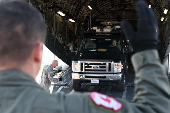 A U.S. Air Force loadmaster assigned to the 517th Airlift Squadron, unloads a communications van off of a C-17 Globemaster III during exercise Arctic ACE at Joint Base Elmendorf-Richardson, Alaska, July 14, 2017. The first of its kind, Arctic ACE was designed to exercise Pacific Air Force's Agile Combat Employment concept of operations, or ACE, by concurrently conducting fifth-generation fighter operations from a main operating base and a forward, austere operating base. (U.S. Air Force photo by Staff Sgt. Westin Warburton)