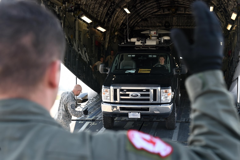 A U.S. Air Force loadmaster with the 517th Airlift Squadron, Joint Base Elmendorf-Richardson, unloads a communications van off of a C-17 Globemaster III during exercise Arctic ACE, Alaska, July 14, 2017. The first of its kind, Arctic ACE was designed to exercise Pacific Air Force's Agile Combat Employment concept of operations, or ACE, by concurrently conducting fifth-generation fighter operations from a main operating base and a forward, austere operating base.