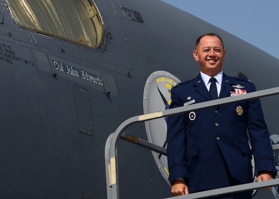 Col. John R. Edwards, commander of the 28th Bomb Wing, unveils his name on a B-1 bomber at Ellsworth Air Force Base, S.D., Aug. 9, 2017. Edwards earned his commission through the Reserve Officers' Training Corps in 1995. He is a Master Combat Systems officer with more than 2,400 flight hours and 237 combat hours. (U.S. Air Force photo by Airman 1st Class Donald C. Knechtel)