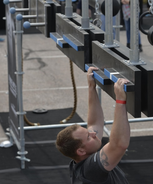 An Ellsworth Airman works to complete the Alpha Warrior Battle Rig at Ellsworth Air Force Base, S.D. Aug. 5, 2017.  The Alpha Warrior Battle Rig required participants to use more than just their brawn, it also tested their endurance, resiliency and will power. (U.S. Air Force photo by Airman 1st Class Michella T. Stowers)